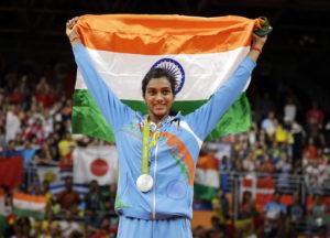 PV Sindhu holding Indian flag