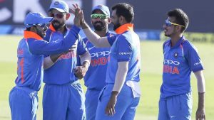 Indian cricketers celebrating wicketfall