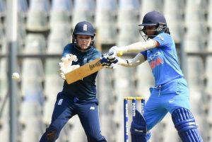 Indian female cricketer hitting a cut shot