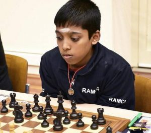 A kid playing chess
